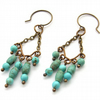 Turquoise howlite bronze chandelier earrings
