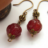 Carved carnelian flower bead earrings