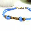 Affirmation bracelet love charm on blue faux suede cord