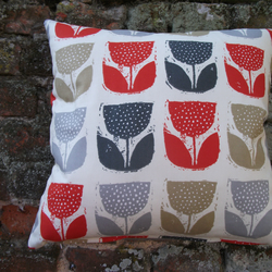 A Handmade Cushion Cover With Very Modern Looking Tulips