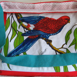 large tote bag featuring a vibrant parrot